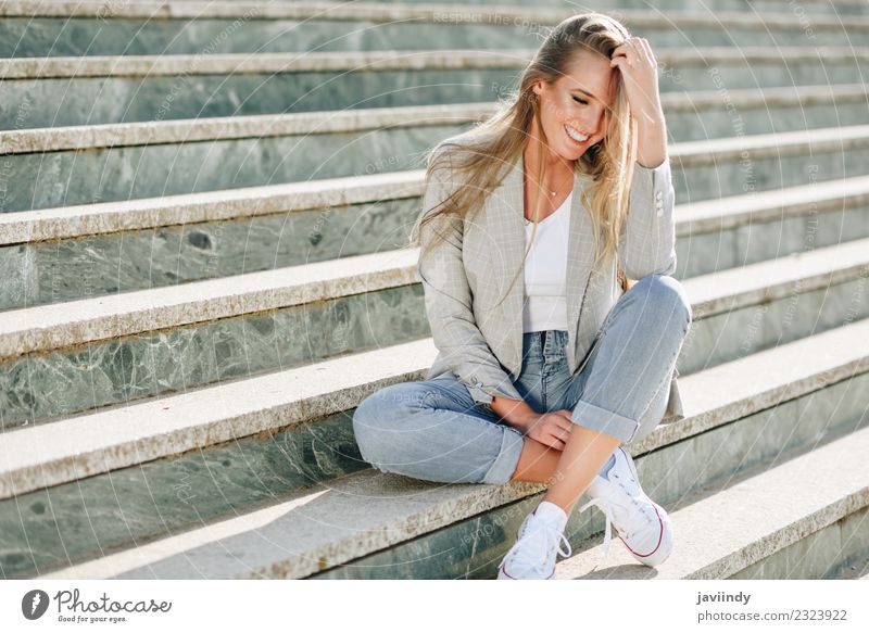 Blond woman smiling sitting in urban steps Lifestyle Beautiful Human being Feminine Young man Youth (Young adults) Woman Adults 1 18 - 30 years Street Fashion