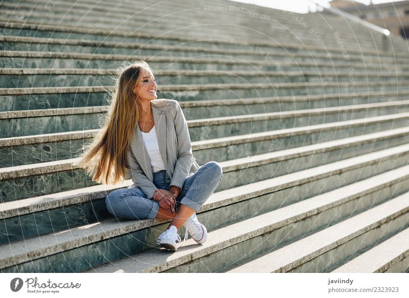 Beautiful young caucasian woman smiling in steps Woman Human being Youth (Young adults) Young woman White Joy 18 - 30 years Adults Street Lifestyle Autumn