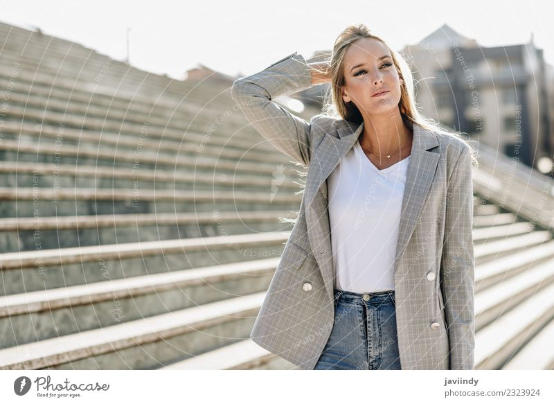 Beautiful young caucasian woman in urban background Lifestyle Style Hair and hairstyles Human being Feminine Young woman Youth (Young adults) Woman Adults 1