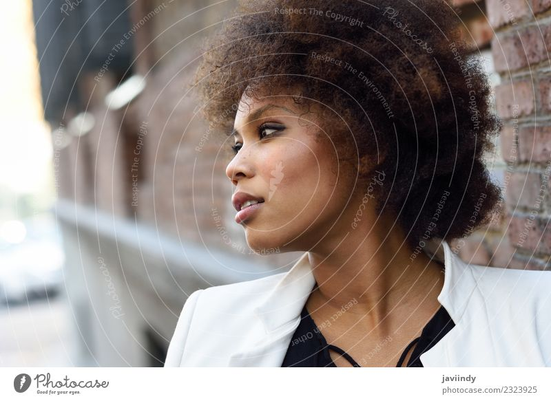 Young black woman with afro hairstyle Lifestyle Style Happy Beautiful Hair and hairstyles Face Human being Woman Adults Street Fashion Jacket Brunette Afro