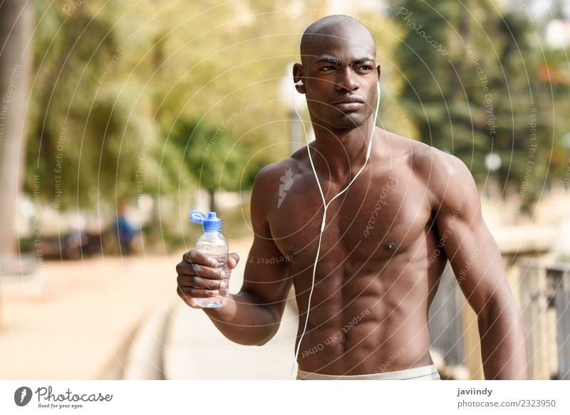 Fit shirtless young black man drinking water after running Drinking Bottle Lifestyle Body Sports Jogging Human being Masculine Young man Youth (Young adults)