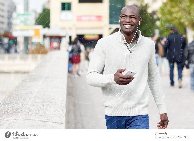 Smiling black man with smartphone in his hand Human being Youth (Young adults) Man Young man Joy 18 - 30 years Black Face Adults Street Lifestyle Happy Fashion