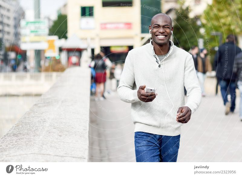 Smiling black man with smartphone in his hand Human being Youth (Young adults) Man Young man Joy 18 - 30 years Black Adults Street Lifestyle Modern Technology
