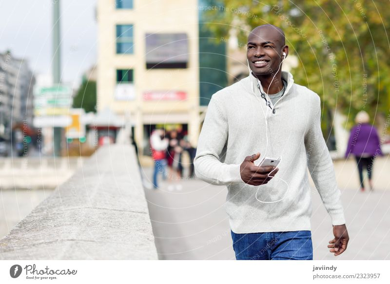 Black man with smartphone in his hand outdoors Lifestyle Happy Beautiful Face Telephone PDA Technology Human being Young man Youth (Young adults) Man Adults 1