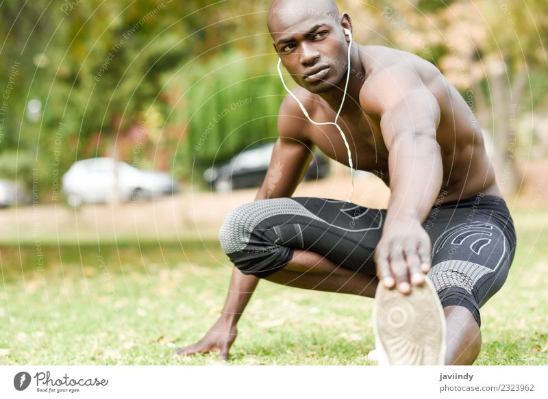 Fit shirtless young black man doing stretching Lifestyle Body Sports Human being Masculine Young man Youth (Young adults) Man Adults 1 18 - 30 years Fitness