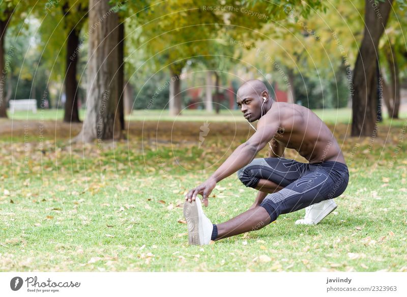 Fit shirtless young black man doing legs stretching Lifestyle Body Sports Human being Masculine Young man Youth (Young adults) Man Adults 1 18 - 30 years