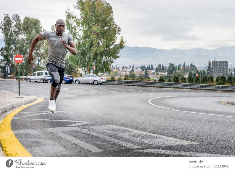 Black man running outdoors in urban road Lifestyle Body Sports Jogging Human being Masculine Young man Youth (Young adults) Man Adults 1 18 - 30 years Fitness