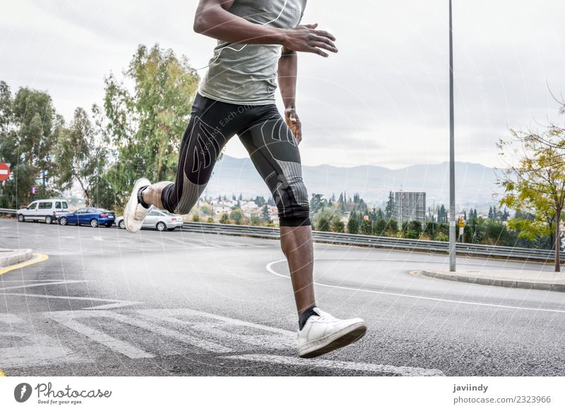 Black man running outdoors in urban road Lifestyle Body Sports Jogging Human being Feminine Young man Youth (Young adults) Man Adults Legs 1 18 - 30 years