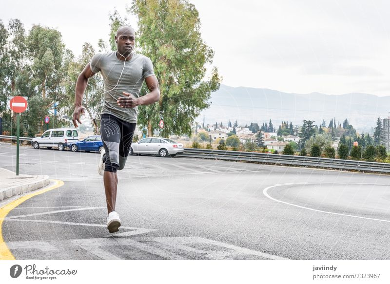 Black man running outdoors in urban road Lifestyle Body Sports Fitness Sports Training Jogging Human being Young man Youth (Young adults) Man Adults 1