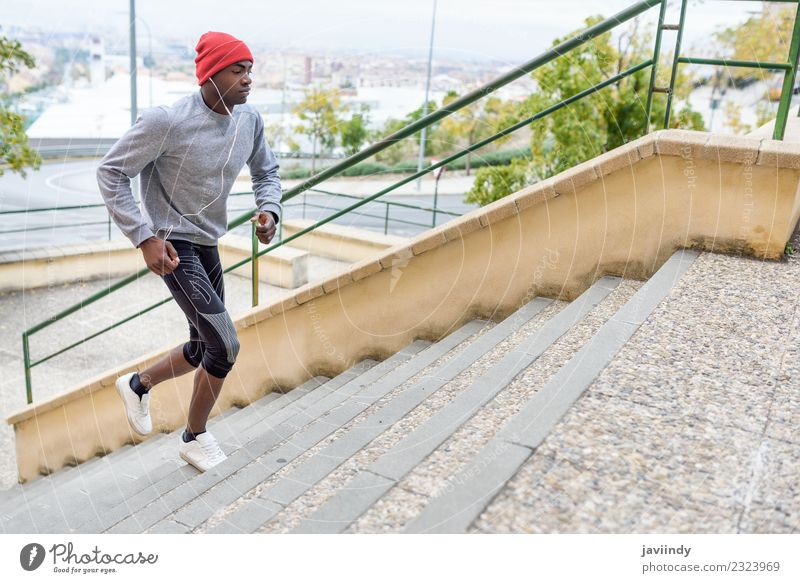 Black man running upstairs outdoors Lifestyle Body Winter Sports Jogging Human being Masculine Young man Youth (Young adults) Man Adults 1 18 - 30 years Fitness