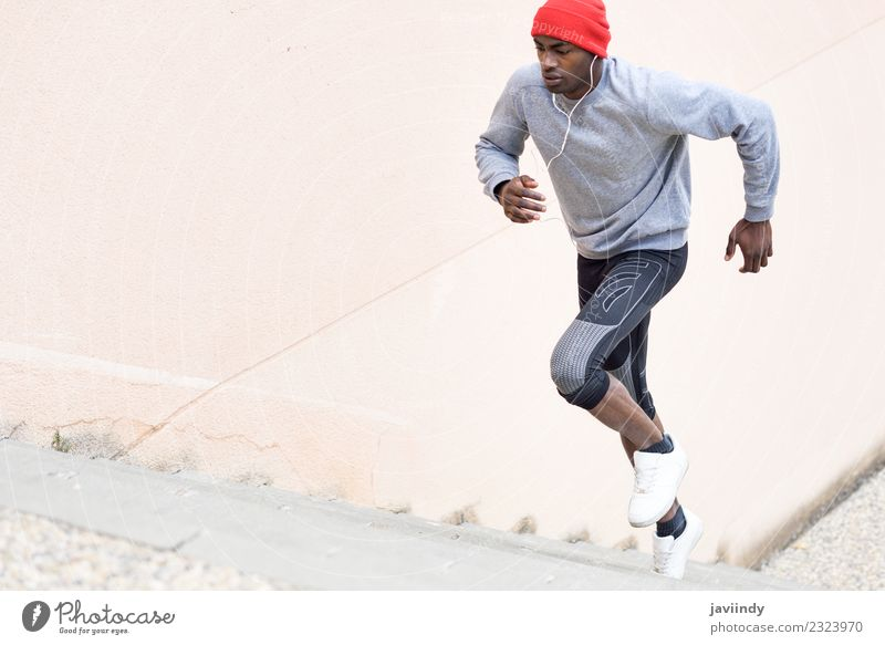Black man running upstairs outdoors Lifestyle Winter Sports Jogging Human being Masculine Young man Youth (Young adults) Man Adults 1 18 - 30 years Fitness