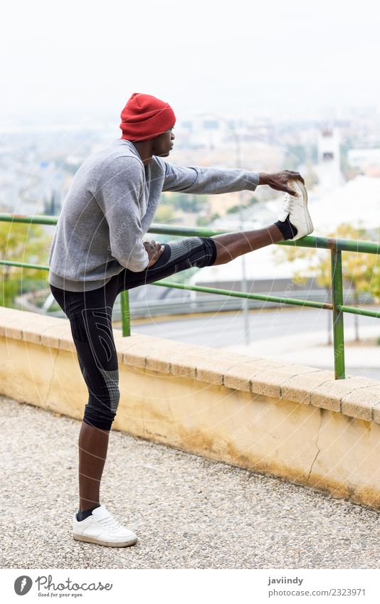 Black man doing stretching after running outdoors. Lifestyle Body Winter Sports Jogging Human being Masculine Young man Youth (Young adults) Man Adults 1