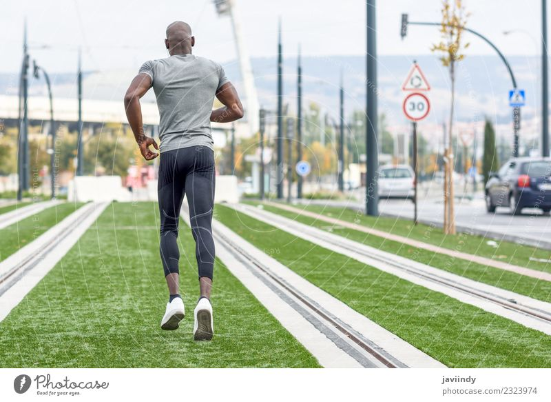 Back view of black man running in urban background. Lifestyle Body Sports Jogging Human being Masculine Young woman Youth (Young adults) Man Adults 1