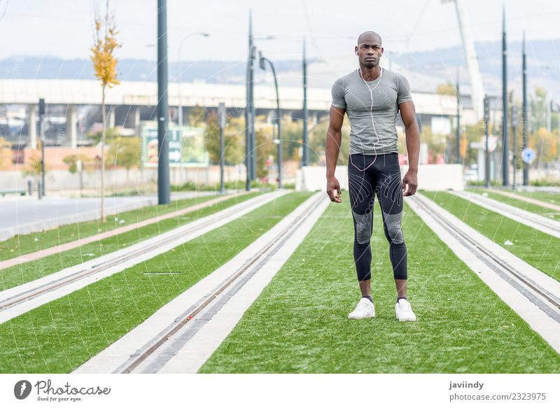Atractive black man ready to running in urban background Lifestyle Sports Jogging Human being Young man Youth (Young adults) Man Adults Feet 1 18 - 30 years
