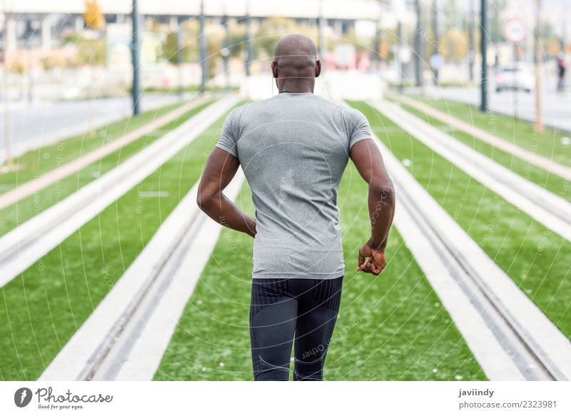 Rear view of black man running in urban background. Lifestyle Body Sports Jogging Human being Masculine Young man Youth (Young adults) Man Adults 1