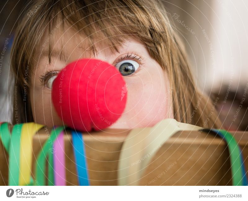 Girl with clown nose looks into the camera Carnival girl Face 1 Human being 3 - 8 years Child Infancy Party Paper streamers Feasts & Celebrations Playing Brash