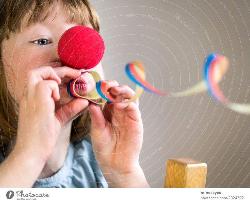 Blond girl with clown nose blows a streamer through the picture. Carnival Feminine Child Infancy Head 1 Human being 3 - 8 years Circus Party