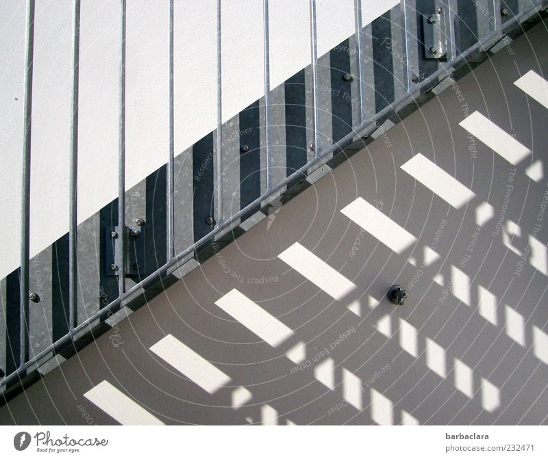 Sunbeam meets cold steel Wall (barrier) Wall (building) Stairs Facade Concrete Metal Steel Line Stripe Pattern Esthetic Bright Cold Modern Gray Silver Design