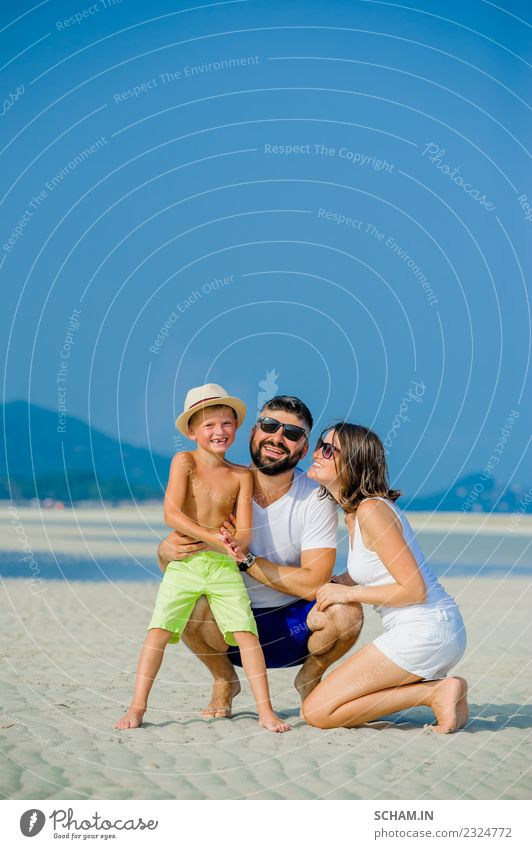 Happy young family of three having fun Lifestyle Joy Playing Summer Ocean Island Infancy Group Sunglasses Beard Smiling Happiness Together 30-34 years 8-9 years