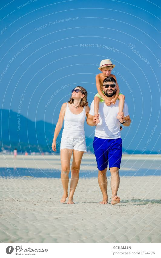 Happy young family of three Lifestyle Joy Playing Summer Ocean Island Infancy Group Sunglasses Beard Smiling Happiness Together 30-34 years 8-9 years Ko Samui