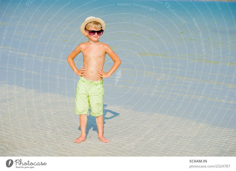 Portrait of a handsome boy on the desert sunny beach Lifestyle Joy Playing Summer Ocean Island Infancy Landscape Sunglasses Smiling Happiness Together 8-9 years