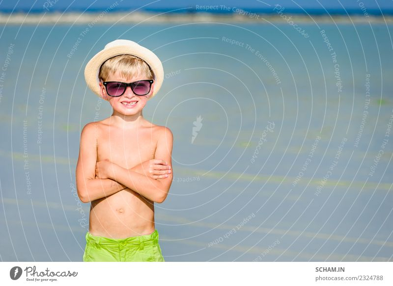 Handsome boy on the desert sunny beach Child Human being Blue Summer Landscape Ocean Joy Lifestyle Laughter Boy (child) Playing Together Infancy Happiness