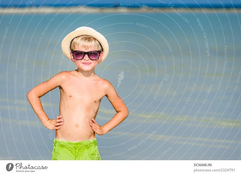 Portrait of a handsome boy at the sunny beach Lifestyle Joy Playing Summer Ocean Island Human being Masculine Child Infancy 1 3 - 8 years Landscape Beach