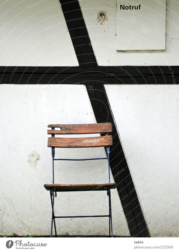waiting Deserted Manmade structures Building Wall (barrier) Wall (building) Facade Stone Wood Characters Old Brown Gray Black White Garden chair Chair