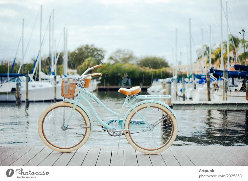 Bicycle on the dock Wheels Cruiser Sailboat Harbour Dock Vacation & Travel Summer Sky Clouds Basket Pedal Wood Water Ocean Lake Tree Tourism Multicoloured Ride