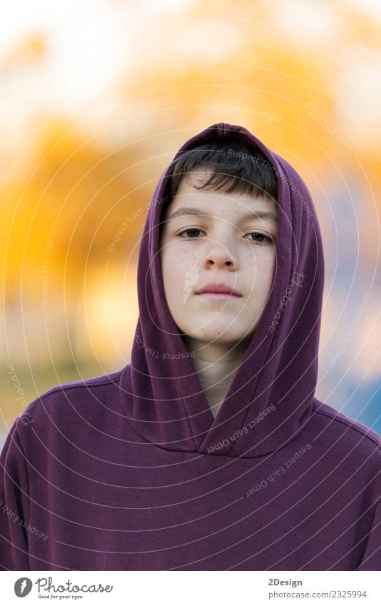 Portrait of a teen wearing a hodded while looking camera Lifestyle Beautiful Face Child Human being Boy (child) Man Adults Infancy Nature Autumn Park Fashion
