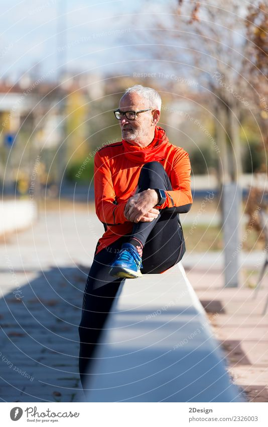 Senior runner man sitting after jogging in a park Human being Nature Man Old Plant Summer Green Relaxation Calm Adults Lifestyle Sports Grass Happy