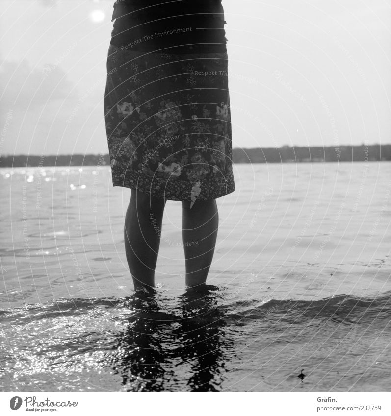 At Wannsee Human being Feminine Woman Adults Legs 1 Water Lakeside Skirt Relaxation To enjoy Stand Gray Vacation & Travel Nature Black & white photo