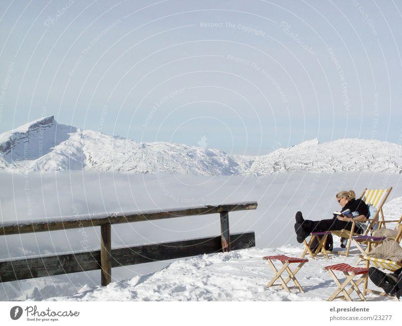 abyss Peak Clouds Fog Edge Woman Deckchair Winter Austria Kleinwalsertal Mountain Snow Handrail Riezlern pulpit wall