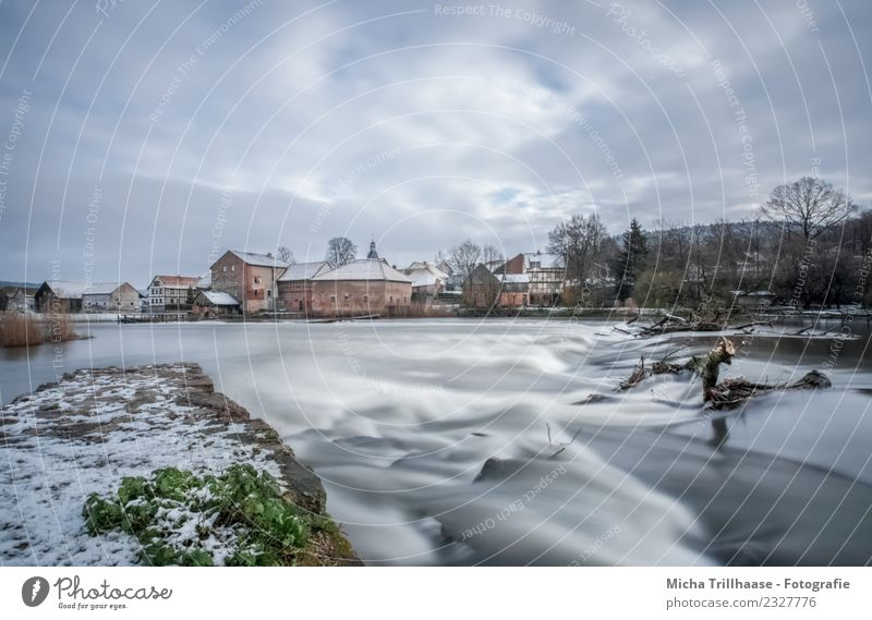 River and rapids in winter Tourism Waves Winter Snow Environment Nature Landscape Water Sky Clouds Sun Weather Wind Ice Frost River bank Waterfall Village Town