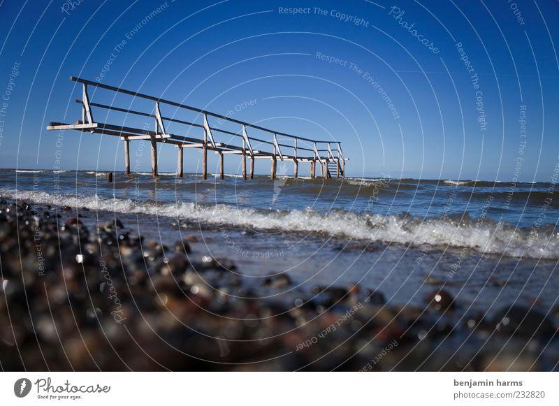 Ocean Beach Calm Landscape Coast Waves Beautiful weather Handrail Baltic Sea Footbridge Surf Cloudless sky Blue sky Gravel beach