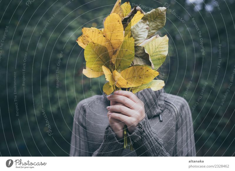 Portrait of a sad teenage girl with leaves Lifestyle Joy Happy Beautiful Face Relaxation Playing Child Human being Woman Adults Hand Nature Autumn Leaf Park