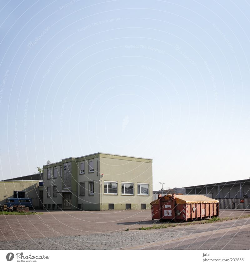 Architecture Building Places Gloomy Manmade structures Factory Company Warehouse Container Courtyard Cloudless sky Blue sky Industrial plant Flat roof Factory yard