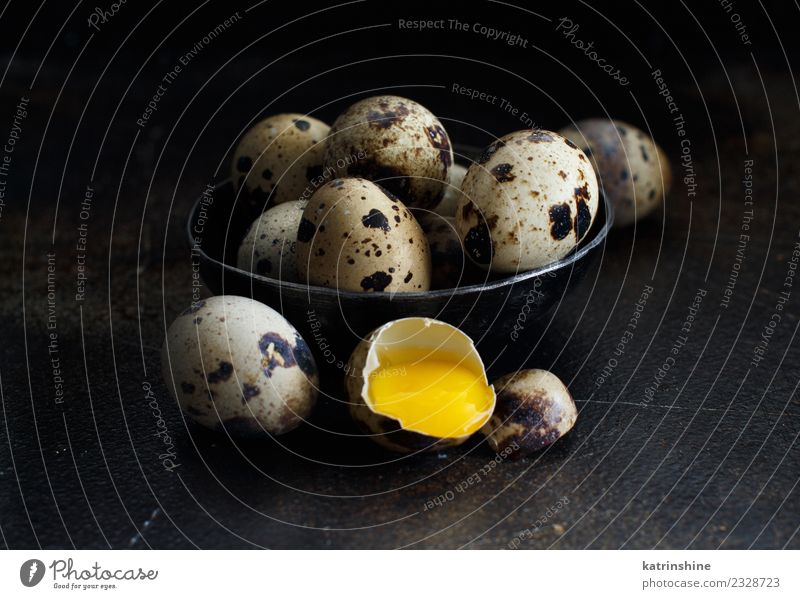 Quail eggs in a bowl on a dark background Food Breakfast Bowl Decoration Feasts & Celebrations Easter Dark Fresh Small Natural Retro Yellow White Tradition