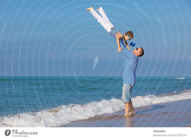 Father and son playing on the beach at the day time. Lifestyle Joy Happy Relaxation Leisure and hobbies Playing Vacation & Travel Trip Freedom Camping Summer