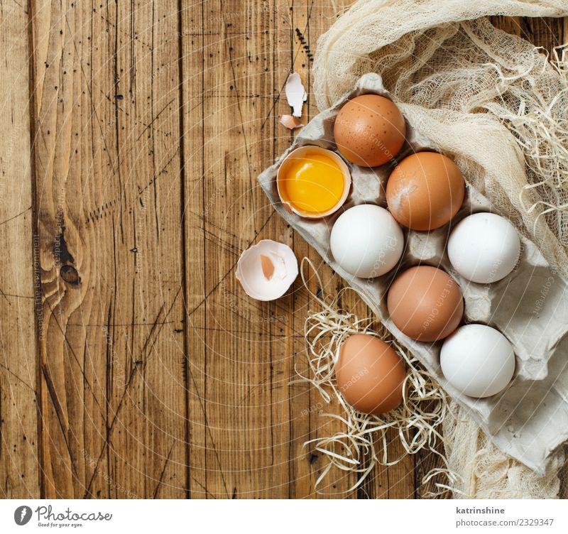 Chicken eggs in a box Breakfast Decoration Feasts & Celebrations Easter Wood Fresh Small Natural Retro Brown Yellow White Tradition background Farm food healthy