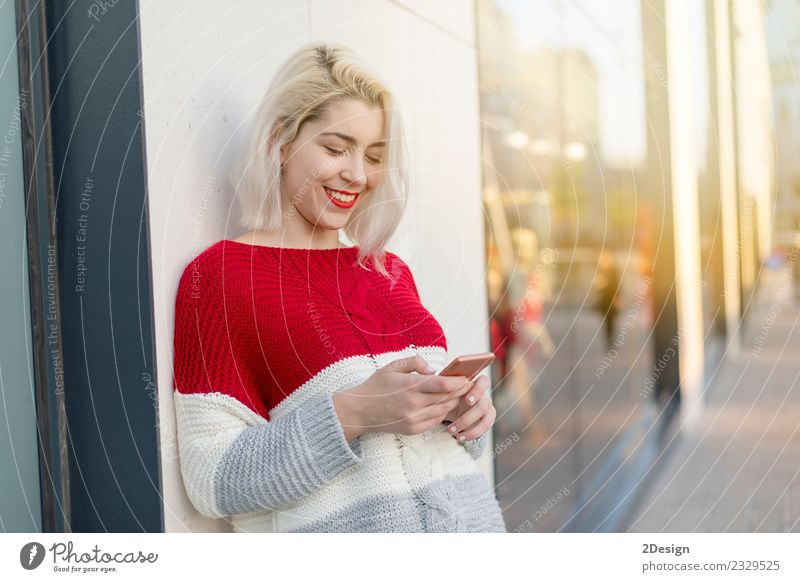 Blonde young woman chatting outdoors Lifestyle Joy Happy Beautiful University & College student Telecommunications Business To talk Telephone Cellphone PDA