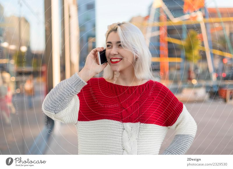 Beautiful woman using mobile in the street. Woman Human being Adults Street Lifestyle To talk Happy Business Modern Communicate Technology Smiling Happiness