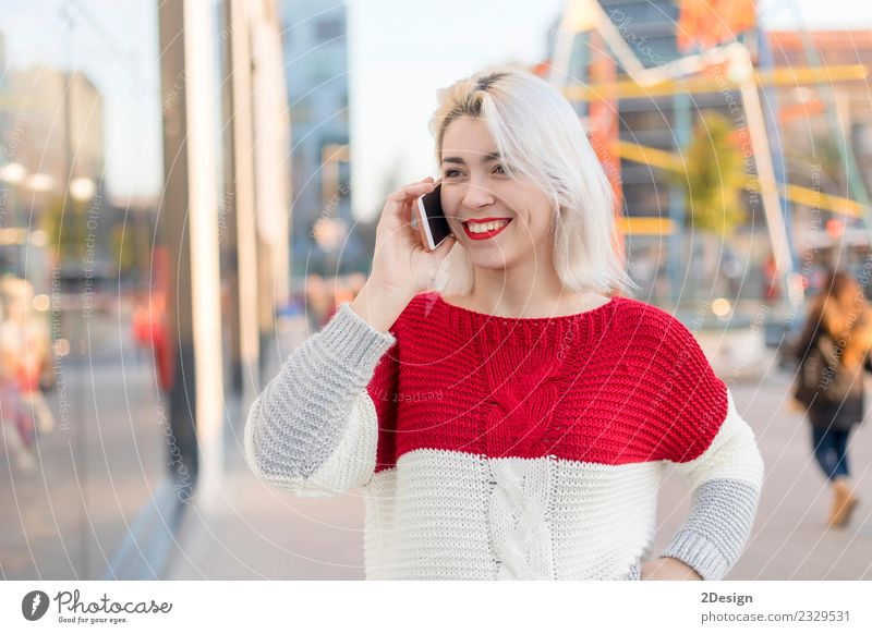 Beautiful woman using mobile in the street. Lifestyle Style Happy Leisure and hobbies Student University & College student Business Success To talk Telephone