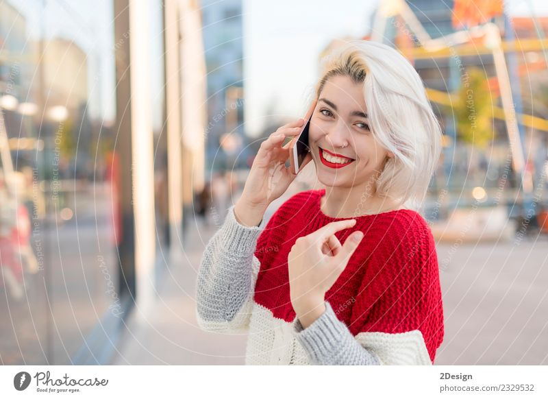 Beautiful woman using mobile in the street. Lifestyle Happy Business To talk Telephone Cellphone PDA Technology Telecommunications Internet Human being Feminine