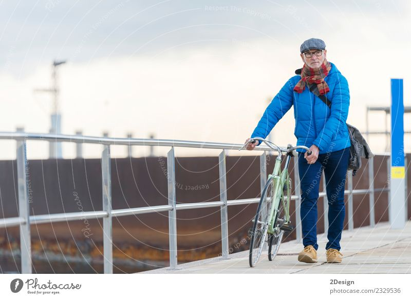Portrait senior man walking with his bicycle next to the sea Lifestyle Elegant Leisure and hobbies Vacation & Travel Freedom Ocean Bicycle Human being Masculine