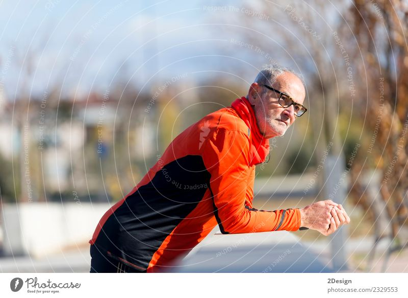 Athletic senior male leaning on fence Human being Nature Man Old Relaxation Adults Lifestyle Senior citizen Sports Health care Leisure and hobbies Masculine