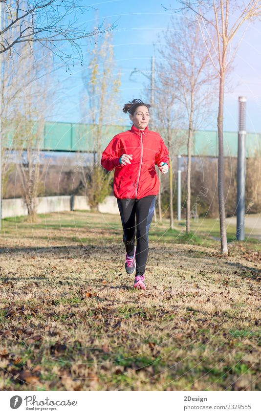 Runner woman jogging at the park Lifestyle Joy Happy Beautiful Athletic Fitness Relaxation Leisure and hobbies Winter Sports Track and Field Sportsperson