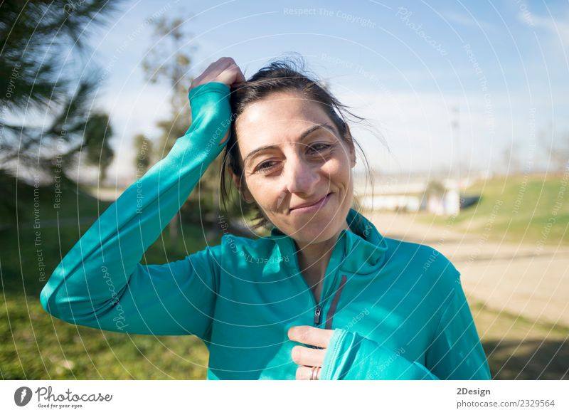 portrait of a runner woman at the park after running Lifestyle Beautiful Summer Sports Jogging Human being Woman Adults Nature Park Fitness Stand Athletic