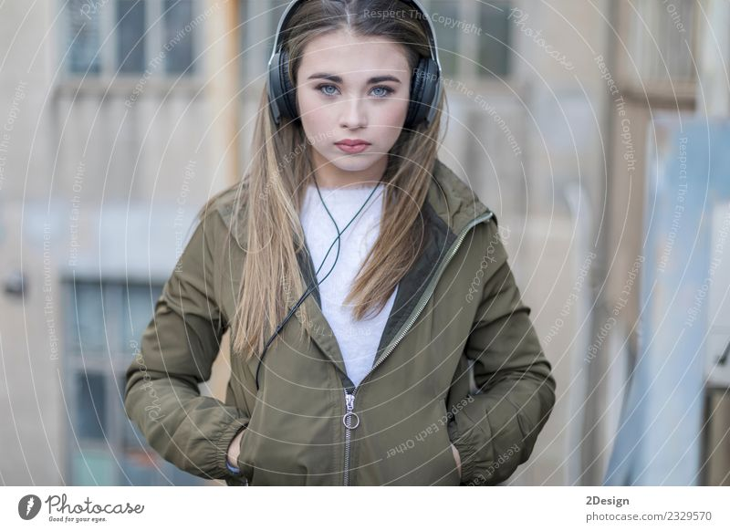 Girl listening music and looking at you Woman Human being Youth (Young adults) Young woman Town Beautiful House (Residential Structure) Adults Street Lifestyle