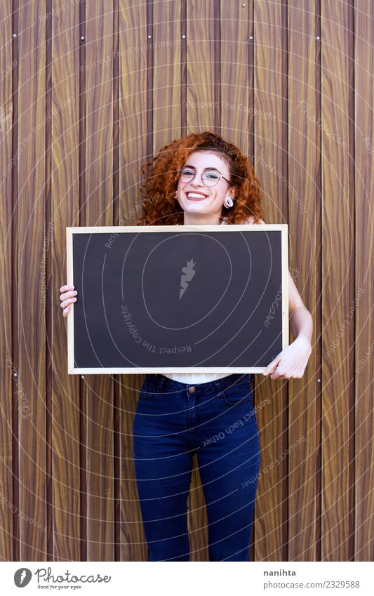 Redhead young woman holding an empty blackboard Human being Youth (Young adults) Young woman Beautiful 18 - 30 years Adults Lifestyle Funny Feminine Wood Style